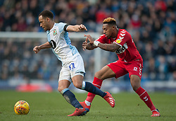 Elliott Bennett of Blackburn Rovers (L) and Britt Assombalonga of Middlesbrough in action - Mandatory by-line: Jack Phillips/JMP - 17/02/2019 - FOOTBALL - Ewood Park - Blackburn, England - Blackburn Rovers v Middlesbrough - English Football League Championship