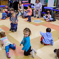 Children and their parents gather for stories and games during Toddler Time at the Gallup Children's Library Wednesday.