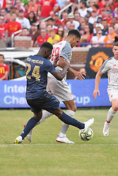 July 28, 2018 - Ann Arbor, MI, U.S. - ANN ARBOR, MI - JULY 28: Manchester United Defender Timothy Fosu-Mensah (24) and Liverpool Forward Dominic Solanke (29) fight for possession in the ICC soccer match between Manchester United FC and Liverpool FC on July 28, 2018 at Michigan Stadium in Ann Arbor, MI. (Photo by Allan Dranberg/Icon Sportswire) (Credit Image: © Allan Dranberg/Icon SMI via ZUMA Press)
