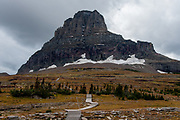 Hidden Lake Trail heading towards Mount Clements at Logan Pass in Glacier National Park, Montana, Tuesday, October 7, 2014. The terminal moraine, a pile of gravel rocks created by the leading edge of a glacier that likely disappeared in the 1940's is visible just below the snowfield.