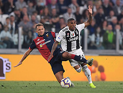 TURIN, Oct. 21, 2018  Juventus' Douglas Costa (R) vies with Genoa's Domenico Criscito during an Italian Serie A soccer match between FC Juventus and Genoa in Turin, Italy, Oct. 20, 2018. The match ended 1-1. (Credit Image: © Alberto Lingria/Xinhua via ZUMA Wire)