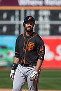 San Francisco Giants first baseman Brandon Belt (9) reacts to the Oakland Athletics catching his hit at the wall at Oakland Coliseum in Oakland, California, on March 25, 2018. (Stan Olszewski/Special to S.F. Examiner)