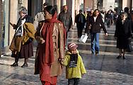 Roma, 03/04/2003: Madre e figlio sotto i portici di piazza Vittorio - Mother and son under the arcades of Piazza Vittorio.©Andrea Sabbadini