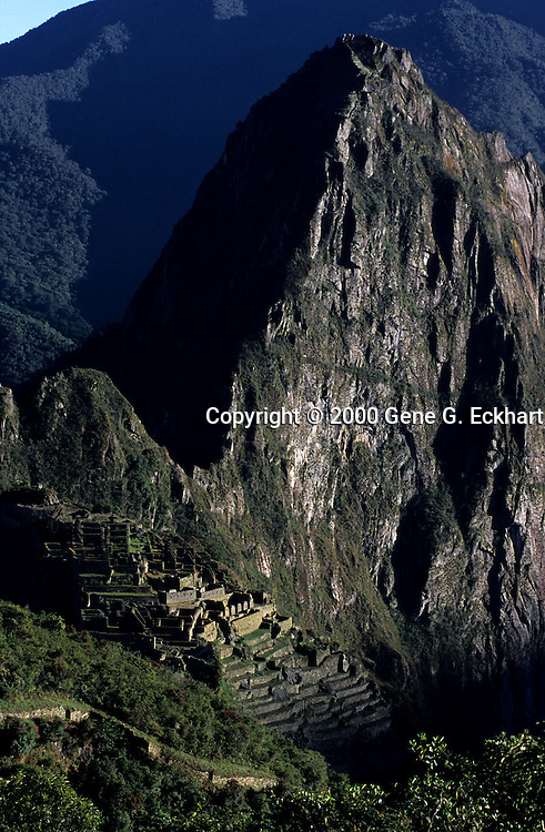 """Machu Picchu is a pre-Columbian Inca site located 2,400 meters (7,875 ft) above sea level. It is situated on a mountain ridge above the Urubamba Valley in Peru, which is 80 km (50 mi) northwest of Cuzco and through which the Urubamba River flows. The river is a partially navigable headwater of the Amazon River. Often referred to as """"The Lost City of the Incas"""", Machu Picchu is one of the most familiar symbols of the Inca Empire. It was built around the year 1460, but was abandoned as an official site for the Inca rulers a hundred years later, at the time of the Spanish conquest of the Inca Empire. Although known locally, it was said to have been forgotten for centuries when the site was brought to worldwide attention in 1911 by Hiram Bingham, an American historian. Machu Picchu was declared a Peruvian Historical Sanctuary in 1981 and a UNESCO World Heritage Site in 1983. It is especially important as a cultural site and considered a sacred place."""