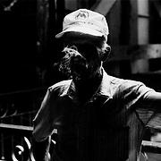 A supervisor at the Partagas cigar factory, Havana, Cuba.