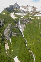 Snow-capped mountains create a waterfall, Katmai National Park, Alaska.