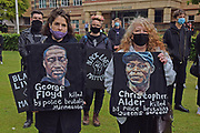 Protesters display images of Christopher Alder and George Flyod both who died in police custody seen here during the Black Lives Matter protest at Queens Gardens, Hull, United Kingdom on 10 June 2020.