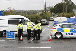 © Licensed to London News Pictures. 16/08/2019. Sulhamstead, UK. The scene at the junction of the A4 and Uftin Lane near Sulhamstead, Berkshire, where a police officer was killed while investigating a suspected burglary. Ten people have been arrested on suspicion of murder including a 13-year-old child. Photo credit: Peter Macdiarmid/LNP