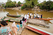 Sept. 27, 2009 -- SUNGAI KOLOK, THAILAND: People leave Thailand to go to Malaysia at an informal border crossing on the Kolok River in Sungai Golok, Narathiwat, Thailand. The Thai-Malaysia border in Narathiwat province sees a steady stream of cross border trade but tourism from Malaysia which once flourished for Malaysians who wanted to drink and enjoy other vices prohibited in Muslim Malaysia has all but stopped since violence by Muslim insurgents in south Thailand destroyed several tourist hotels. Photo by Jack Kurtz / ZUMA Press