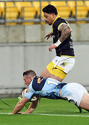 Northland's Jordan Hyland dives on loose ball to score at the feet of Wellington's Ben Lam in the Mitre 10 Rugby match at Westpac Stadium, Wellington, New Zealand, Thursday, October 12 2017. Credit:SNPA / Ross Setford  **NO ARCHIVING**