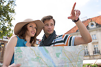 Young tourist couple with map outdoors