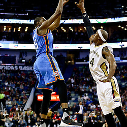 Feb 25, 2016; New Orleans, LA, USA; Oklahoma City Thunder forward Kevin Durant (35) shoots over New Orleans Pelicans forward Dante Cunningham (44) during the first quarter of a game at Smoothie King Center. Mandatory Credit: Derick E. Hingle-USA TODAY Sports