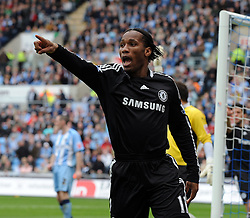 Didier Drogba celebrates scoring during the FA Cup Sponsored by E.ON 6th round match between Coventry City and Chelsea at the Ricoh Arena on March 7, 2009 in Coventry, England.