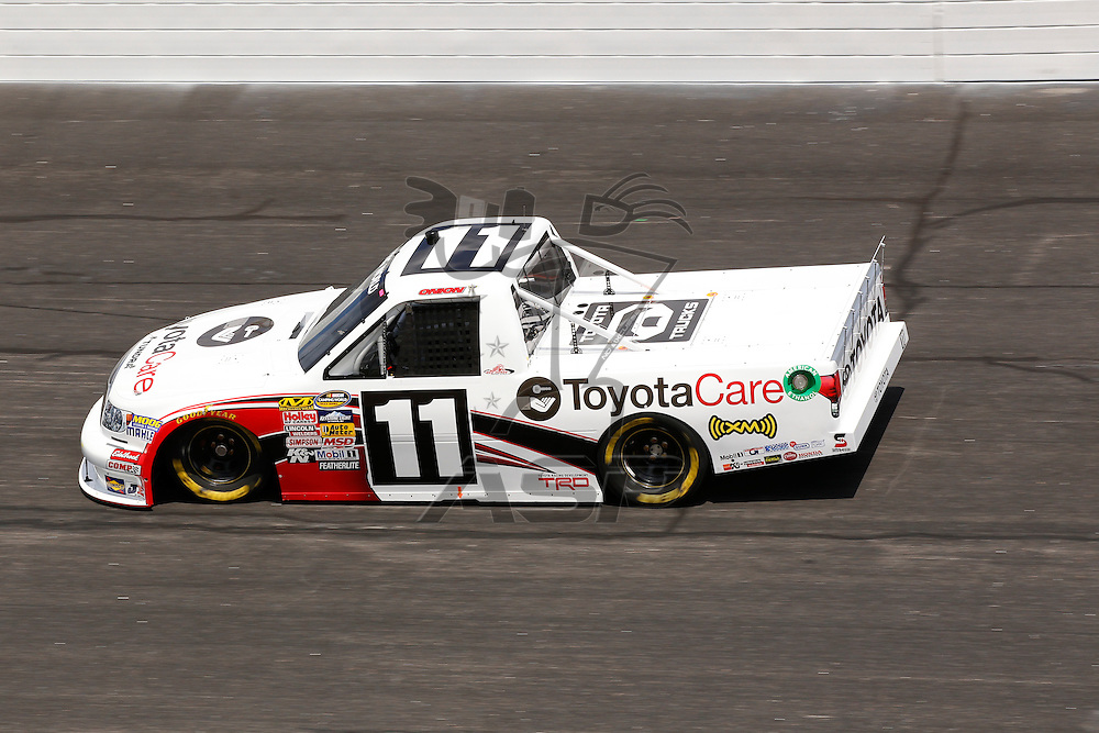 ROCKINGHAM, NC - APR 13, 2012:  Todd Bodine (11) brings his truck through the turns during a practice session for the Inaugural Good Sam Roadside Assistance 200 at the Rockingham Speedway in Rockingham, NC.