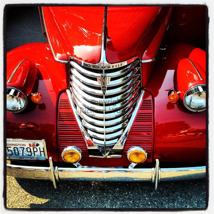 2012 SEPTEMBER 16 - Vintage red Oldsmobile car in Seattle, WA, USA. Taken with Apple iPhone using Instagram App. By Richard Walker