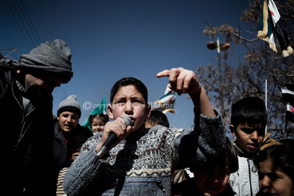 SYRIA - Homs province: This picture shows a child as he is singing during an anti-regime demonstration in Homs province on February 20, 2012. ALESSIO ROMENZI