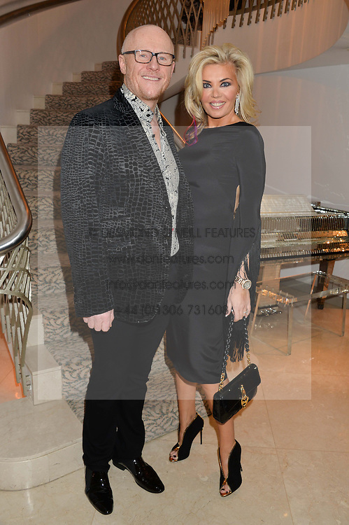JOHN CAUDWELL businessman and philanthropist and his wife CLAIRE CAUDWELL at the Fortune Forum Club dinner in the presence of HSH Prince Albert II of Monaco held at The Dorchester, Park Lane, London on 15th January 2014.