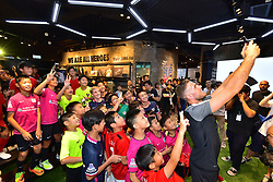 HONG KONG, CHINA - Wednesday, July 19, 2017: Liverpool's captain Jordan Henderson takes a selfie with children from the Nike Academy Invitational Group during a visit to a new Nike store in the Mong Kok district of Hong Hong. (Pic by Pool/Nike/Propaganda)