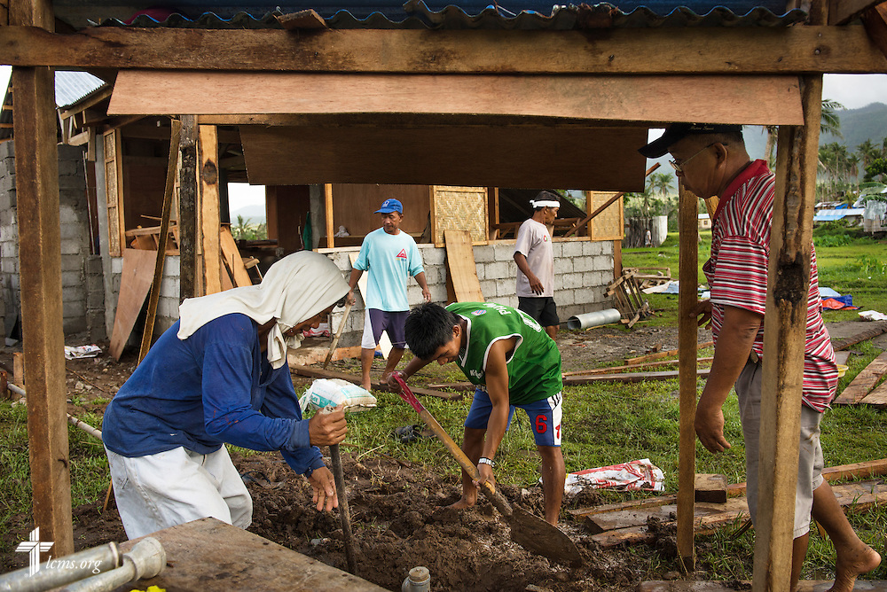 Workers build a well (foreground) and parsonage (rear) next to Christ Lutheran Church in Mayahag, Leyte Province, Philippines, on Saturday, March 15, 2014. LCMS disaster dollars helped the reconstruction efforts following Typhoon Haiyan last year. LCMS Communications/Erik M. Lunsford