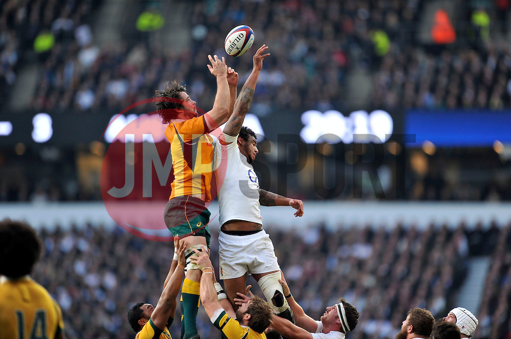 Sam Carter of Australia competes with Courtney Lawes of England for the ball at a lineout - Photo mandatory by-line: Patrick Khachfe/JMP - Mobile: 07966 386802 29/11/2014 - SPORT - RUGBY UNION - London - Twickenham Stadium - England v Australia - QBE Internationals