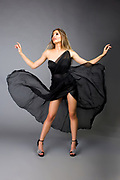 Studio fashion photo of model flipping chiffon skirt. Fasion photo by Gerard Harrison, Image Theory Photoworks.  Model Elodie Tusac.