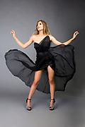 Studio fashion photo of model flipping chiffon skirt. Fasion photo by Gerard Harrison, Image Theory Photoworks.  Model Elodie Tusac.