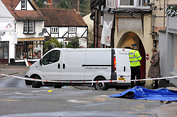 © Licensed to London News Pictures. 24/12/2015<br /> Private ambulance taking the body away   2.20pm.<br /> Costa Coffee car crash Westerham in Kent. Six people taken to hospital.<br /> (Byline:Grant Falvey/LNP)