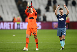 Tottenham Hotspur goalkeeper Paulo Gazzaniga (left) and Juan Foyth celebrate at the end of the Carabao Cup, Fourth Round match at the London Stadium.
