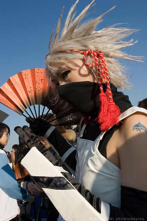"""Cosplayer dressed as """"Narutono Kakashi"""" anime character. TOKYO COMIC MARKET """"COMIKET"""" the biggest comic market in Japan. Independent designers come to sell their comics, there is anime, manga, cosplay, toys, posters etc. At """"Tokyo Big Sight"""" exhibition center."""
