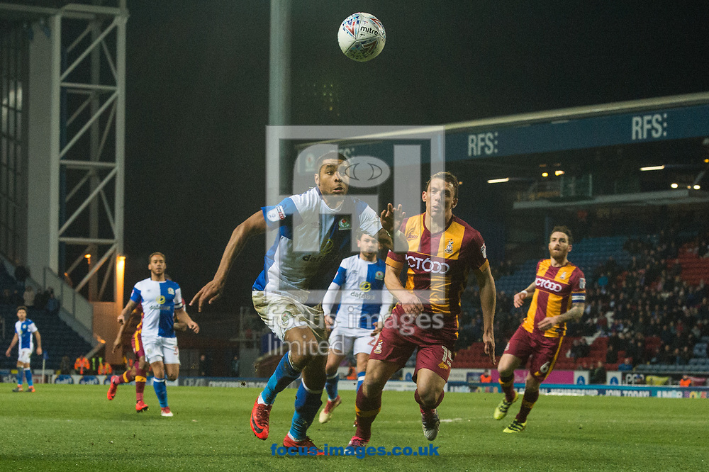 Dominic Samuel of Blackburn Rovers and Stephen Warnock of Bradford City chase a loose ball during the Sky Bet League 1 match at Ewood Park, Blackburn<br /> Picture by Matt Wilkinson/Focus Images Ltd 07814 960751<br /> 29/03/2018