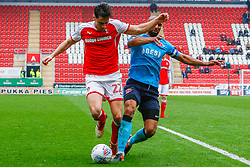 Nathan Pond of Fleetwood Town sticks a foot out to tackle Joe Newell of Rotherham United - Mandatory by-line: Ryan Crockett/JMP - 07/04/2018 - FOOTBALL - Aesseal New York Stadium - Rotherham, England - Rotherham United v Fleetwood Town - Sky Bet League One