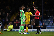 Jamie Mackie of Oxford United receives a yellow card during the EFL Sky Bet League 1 match between Southend United and Oxford United at Roots Hall, Southend, England on 6 October 2018.