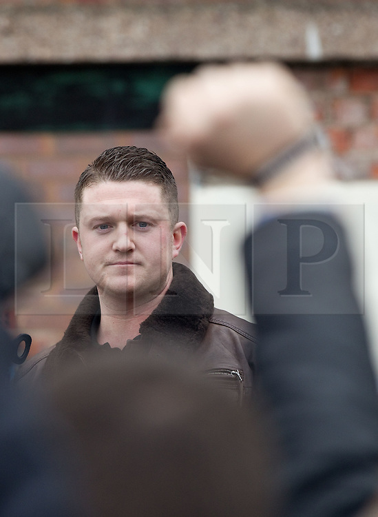 © licensed to London News Pictures. Hyde, UK  25/02/2012. EDL leader Tommy Robinson (aka Stephen Yaxley-Lennon) addresses the crowd at an EDL demo in Hyde. The EDL demonstrate following an assault on Daniel Stringer-Prince. The victim's family said they did not want the EDL to demonstrate in their town in their son's name. It is alleged he was assulted by a gang of Asian men. At the same time, the BNP hold a rally in the town. Photo credit should read Joel Goodman/LNP
