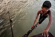 A street boy bathes in the polluted Buriganga river.