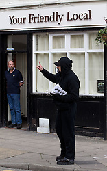 © licensed to London News Pictures. Hyde, UK  25/02/2012. BNP supporters hand out flyers in Hyde on the same day as an EDL demonstration. Photo credit should read Joel Goodman/LNP