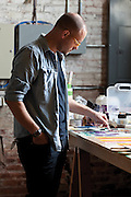 Springfield Missouri artist Jeff Broekhoven painting in his studio.