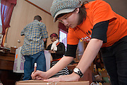 18537Students volunteering at a local church in Mineral, Ohio during MLK Day on January 21, 2008..Ashley Diaz marks boxes.