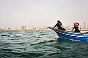 High school students enjoy a field trip on the Mediterranean Sea off the coast of Gaza, where a ten-minute boat ride is the epitome of freedom. Gazans are not allowed to travel outside of the enclave due to the siege, including limiting fishermen and all boats to (aproximately) six nautical miles off the coast.