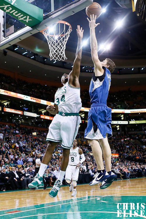 05 December 2012: Minnesota Timberwolves point guard Luke Ridnour (13) goes for the layup over Boston Celtics small forward Paul Pierce (34) during the Boston Celtics 104-94 victory over the Minnesota Timberwolves at the TD Garden, Boston, Massachusetts, USA.