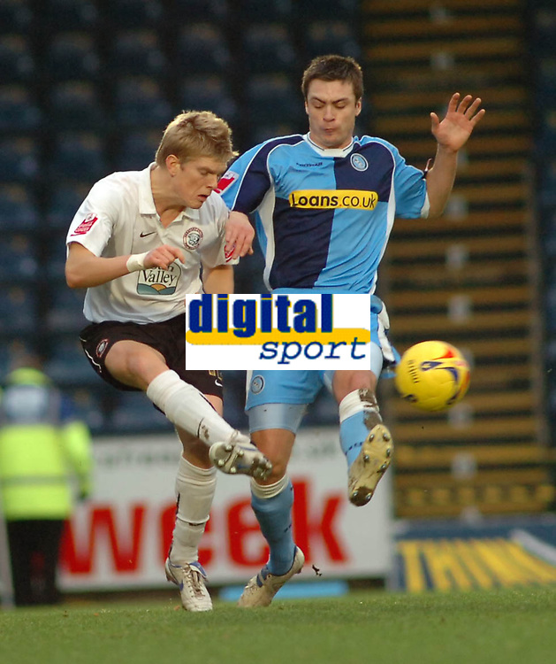 Photo: Kevin Poolman.<br />Wycombe Wanderers v Hereford United. Coca Cola League 2. 01/01/2007. Hereford's Alan Connell clears the ball from Wycombe's Russell Martin.