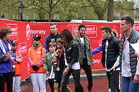 Mini London marathon 2015, The Borough Challenge Boys Under 13 race.  Victoria Beckham puts her arm around her son Romeo Beckham (12) after the finish of the race on The Mall. The Virgin Money London Marathon, Sunday 26th April 2015.<br /> <br /> Scott Heavey for Virgin Money London Marathon<br /> <br /> For more information please contact Penny Dain at pennyd@london-marathon.co.uk
