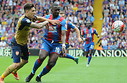 Hector Bellerin and Yannick Bolasie fight for posession during the Barclays Premier League match between Crystal Palace and Arsenal at Selhurst Park, London, England on 16 August 2015. Photo by Michael Hulf.