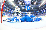 TAMPA, FL - MAY 24: Goalie Andrei Vasilevskiy #88 of the Tampa Bay Lightning stretches but misses the save against Bryan Rust #17 of the Pittsburgh Penguins and lets in a goal during the third period of Game Six of the Eastern Conference Finals in the 2016 NHL Stanley Cup Playoffs at the Amalie Arena on May 24, 2016 in Tampa, Florida.  (Photo by Scott Audette/NHLI via Getty Images)