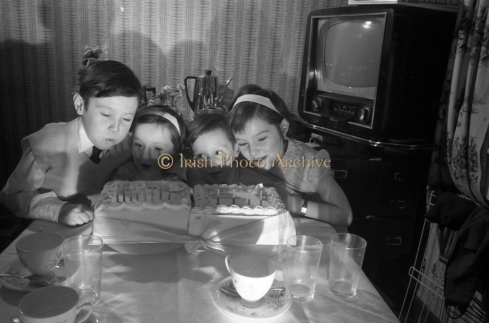 Imagine having an 'official' birthday only every four years! Here, two sets of Leap Year twins, Jimmy (8), Patricia and Robert (4), and Ann (8) MacDonnell, blow out the candles on their birthday cakes. All were born on 29th February.  .28.02.1964