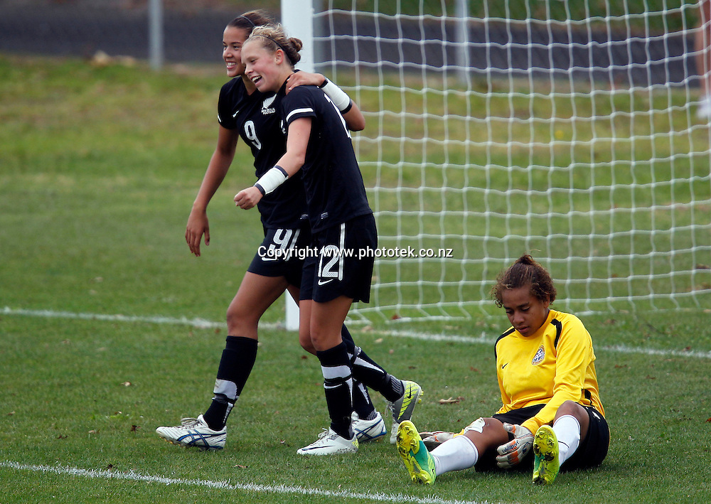 New Zealand celebrate a goal. OFC U-17 Women's Championship, New Caledonia v New Zealand, Centre Park Mangere, Wednesday 11th April 2012. Photo: Shane Wenzlick