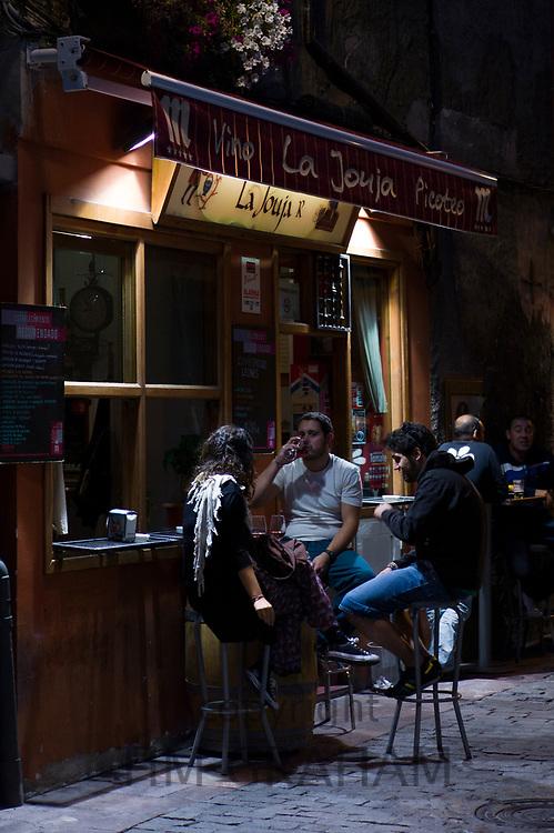 Local young people gather at Tapas Bar La Jouja in Plaza Torres de Omana in Leon, Catilla y Leon, Spain