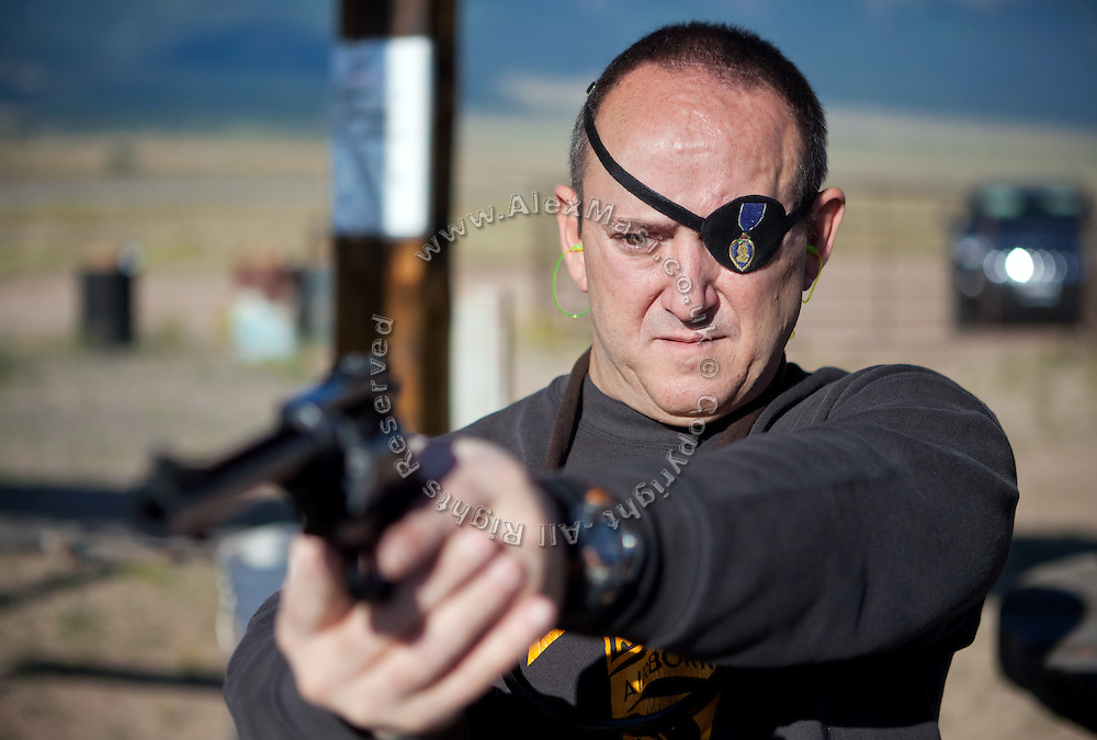 John Daniel Shannon, 48, a former US Army Senior Sniper, is shooting his .44 Magnum in a range near his home in Westcliffe, CO, USA, where he retired with his family after a serious brain injury inflicted by an insurgent sniper in Ramadi, Al Anbar Province, Iraq, on November 13th 2004. Daniel fought during the Second Battle of Fallujah and was then moved to nearby Ramadi. Daniel lost his left eye and has multiple health issues because of his injury: memory problems, balance problems, he can't smell and taste well anymore, he suffers from PTSD, has  troubles with large crowds and city surroundings. This is the reason why he and his family moved to a quiet location on the Rocky Mountains. In 2007 Dan helped the Washington Post to uncover patients' neglect at the Walter Reed Army Medical Center; he also testified before Congress. Torrey, 42, his wife, is a freelance writer and a contributor for the Huffington Post; she's also campaigning to improve the situation of veterans' families.