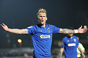 AFC Wimbledon midfielder Mitchell (Mitch) Pinnock (11) with arms apart during the EFL Sky Bet League 1 match between AFC Wimbledon and Southend United at the Cherry Red Records Stadium, Kingston, England on 24 November 2018.