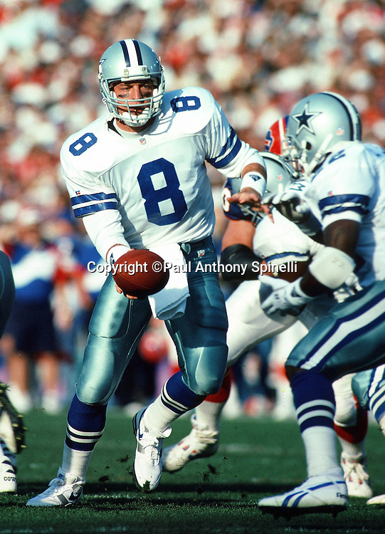 Dallas Cowboys quarterback Troy Aikman (8) hands off the ball to Dallas Cowboys running back Emmitt Smith (22) during the NFL Super Bowl XXVII football game against the Buffalo Bills on Jan. 31, 1993 in Pasadena, Calif. The Cowboys won the game 52-17. (©Paul Anthony Spinelli)