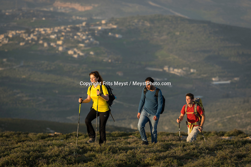 Sebastia, Palestine, March 2015. Hikers on Mt Bayzeed on the section between Sanur and Sebastia. The Abraham Path is a long-distance walking trail across the Middle East which connects the sites visited by the patriarch Abraham. The trail passes through sites of Abrahamic history, varied landscapes, and a myriad of communities of different faiths and cultures, which reflect the rich diversity of the Middle East. Photo by Frits Meyst / MeystPhoto.com for AbrahamPath.org